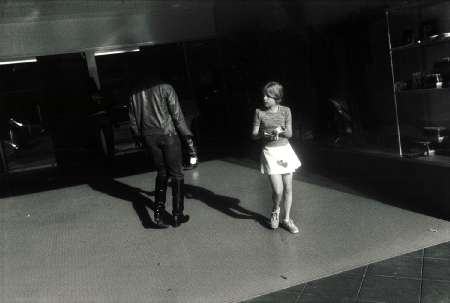 Garry Winogrand Woman wearing a short skirt with hearts
