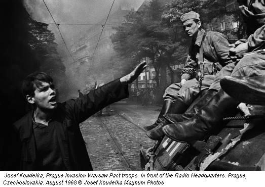 Josef Koudelka, Prague Invasion Warsaw Pact troops. In front of the Radio Headquarters. Prague, Czechoslovakia. August 1968 © Josef Koudelka Magnum Photos