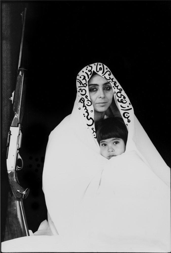 Shirin Neshat Woman of Allah, 1994 Stampa fotografica ai sali d'argento, ritoccata a mano con inchiostro Gelatin silver print retouched by hand with ink 20 x 25 cm Courtesy Galleria Fumagalli, Milano