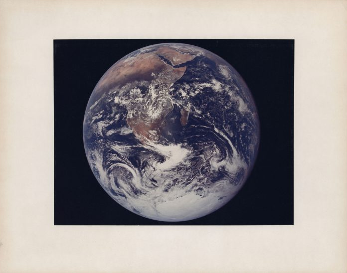 """The """"Blue Marble"""", the first human-taken photograph of the Earth fully illuminated, December 7-19, 1972. Stima: GBP 15,000 - GBP 25,000. Christie's, Voyage to Another World"""