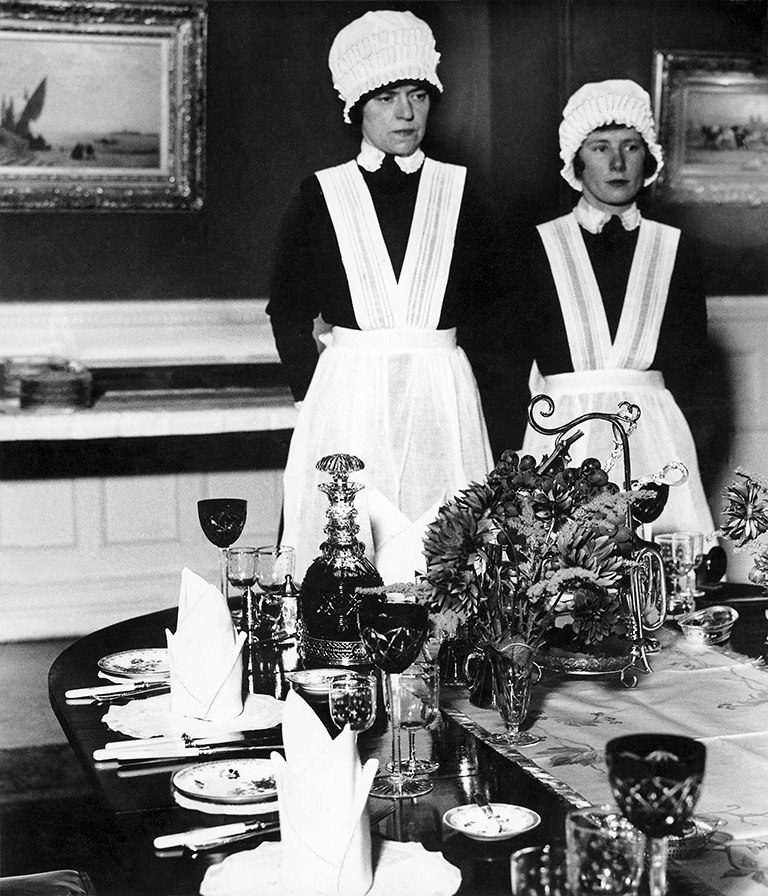 Bill Brandt Parlourmaid and Under-parlourmaid ready to serve dinner, 1936 Private collection, Courtesy Bill Brandt Archive and Edwynn Houk Gallery. © Bill Brandt / Bill Brandt Archive Ltd.