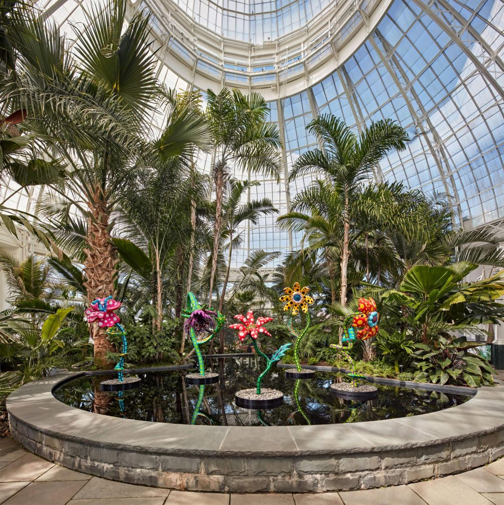 """""""My Soul Blooms Forever"""" (2019), view at the New York Botanical Garden, urethane paint on stainless steel, installation dimensions variable. Collection of the artist, courtesy of Ota Fine Arts, Victoria Miro, and David Zwirner"""